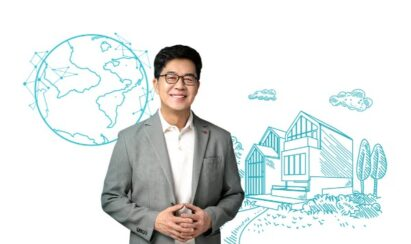 LG's president & CTO Dr. I.P. Park standing in front of an illustration of the LG ThinQ Home