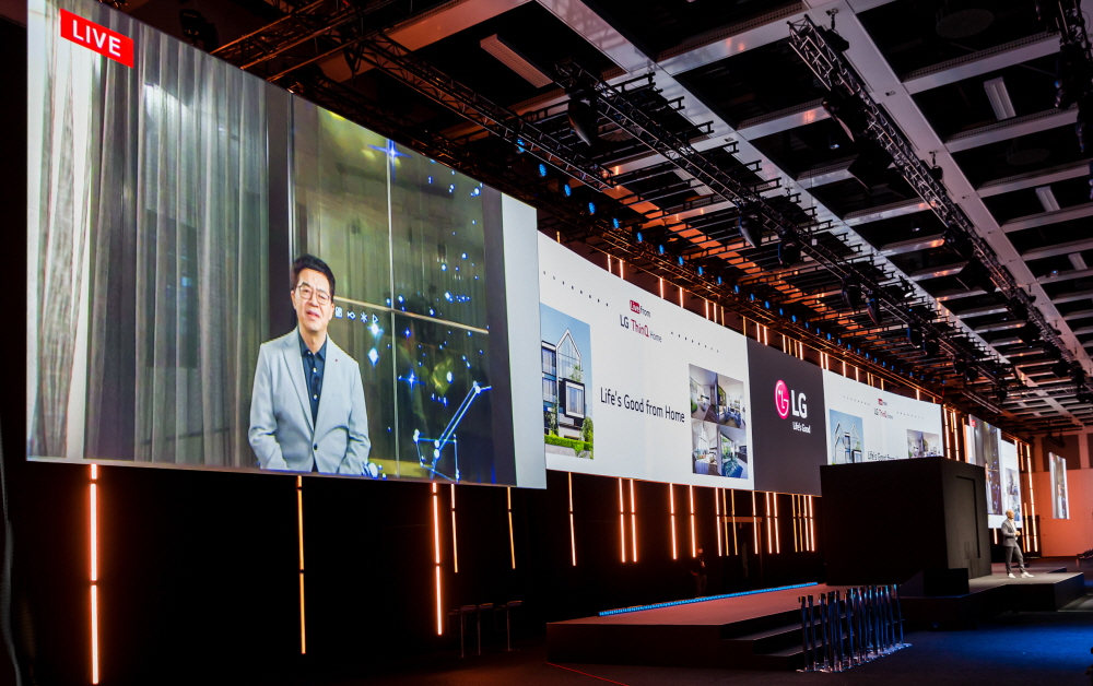 Dr. I.P. Park, president and CTO of LG Electronics, is shown live on a large screen at the LG press conference to introduce the company's new consumer experience at IFA 2020