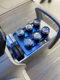A closer look at the drinks compartment located between the two back seats, which is open and already storing six can