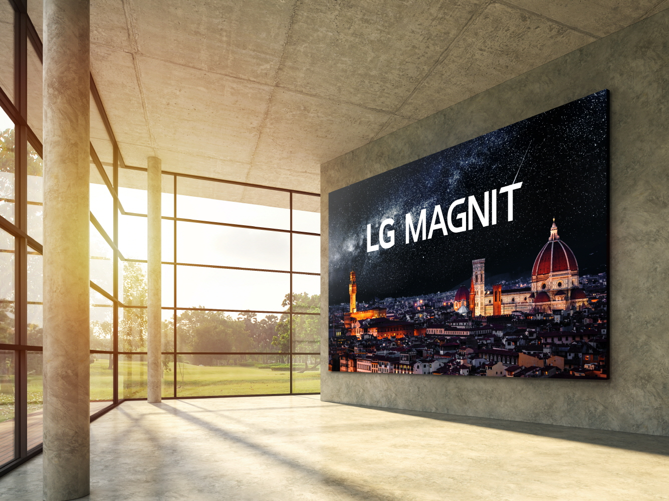 A modern interior space boasting natural light from its expansive windows has LG MAGNIT hanging on the wall, the new Micro LED signage solution displaying a beautiful, crystal-clear night scene of Italian city Florence