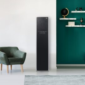 LG Styler which employs pure water-powered TrueSteam™ technology stands on the wall of a modern living space