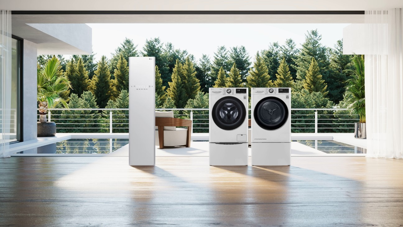 LG's sustainable life appliances, including its Styler, washer and dryer, displayed in a modern room that opens up into a green forest
