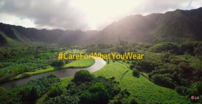 An image for LG's campaign, #CareForWhatYouWear for sustainable lifestyle, which displays a beautiful green landscape with trees, grass, and a river running through the middle
