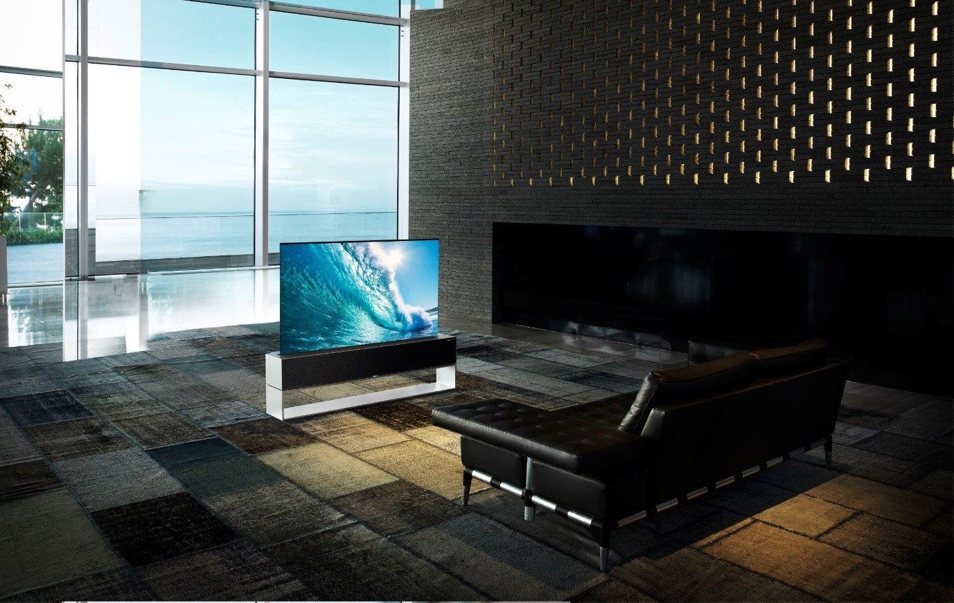 LG SIGNATURE OLED R positioned in a modern living space while vividly displaying crashing waves