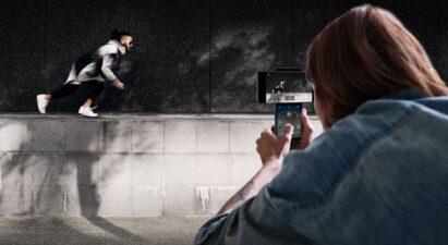 Someone taking a video of their friend doing parkour using LG Wing's Gimbal Motion Camera to stabilize the picture
