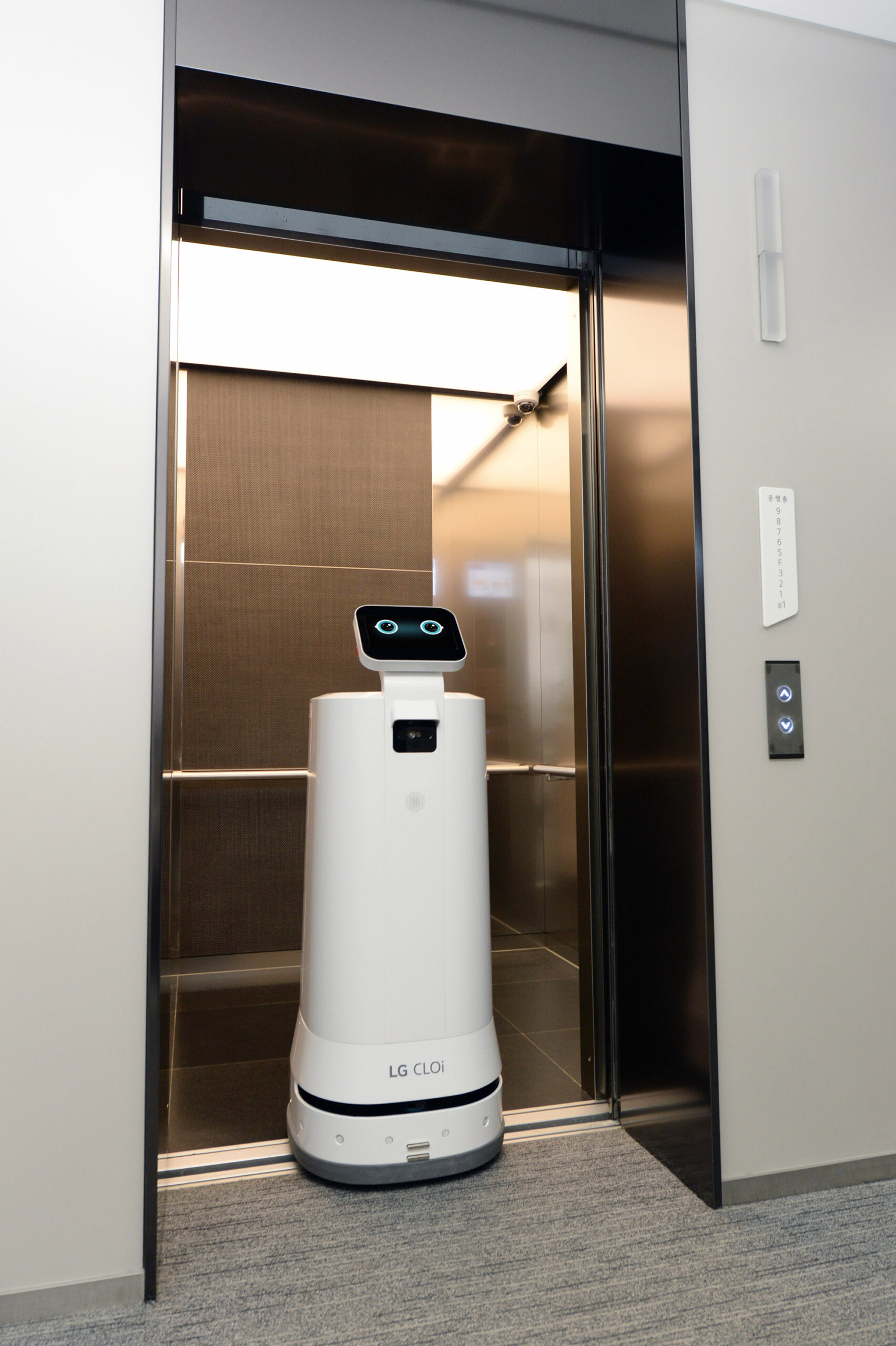 LG CLOi ServeBot exiting an elevator
