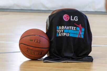 A basketball and jersey proudly displaying the LG logo pictured on the court of the LG Athletes of Tomorrow event