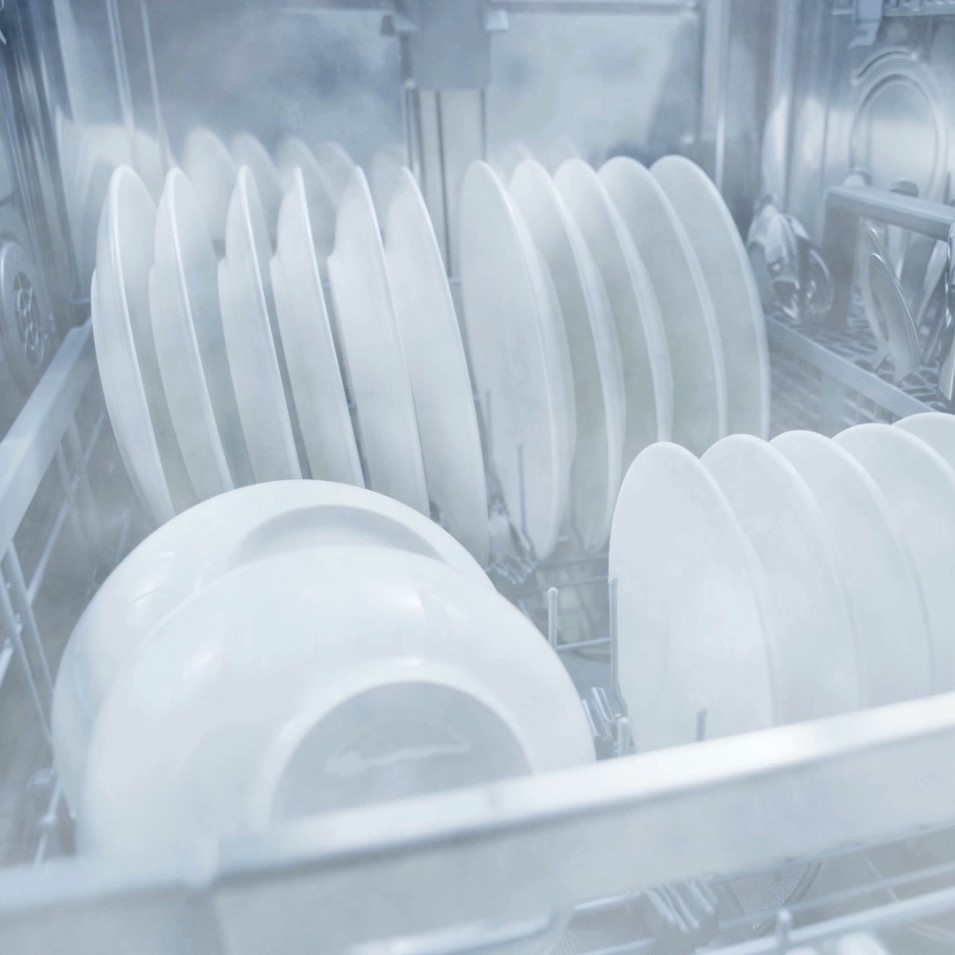 Dishes being washed inside the LG QuadWash™ dishwasher via LG's chemical-free EasyClean™ system