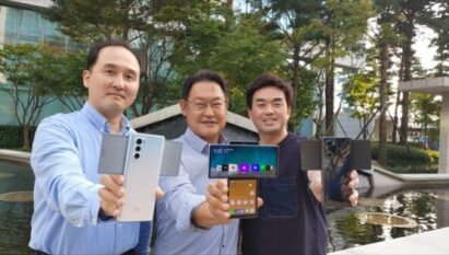 Three members of the LG MC team who worked closely on the LG WING development project hold up the device in Swivel mode while showcasing its different colors