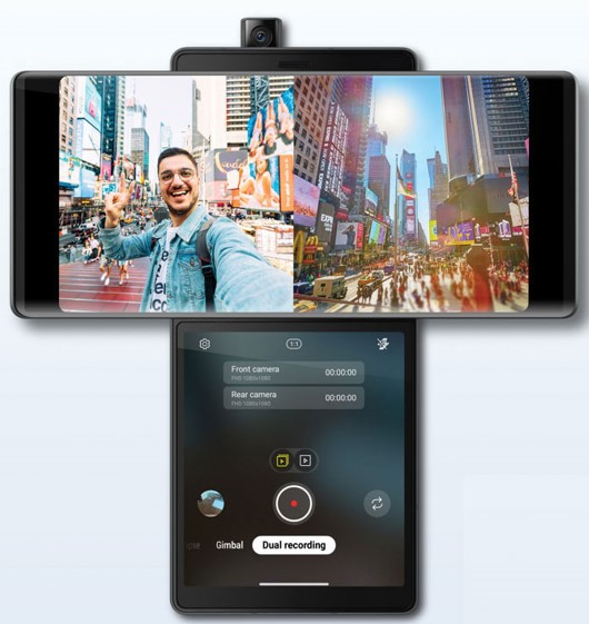 LG WING's Dual Recording mode lets a man record himself on the famous Times Square steps via the pop-up camera while simultaneously filming the square from its rear camera