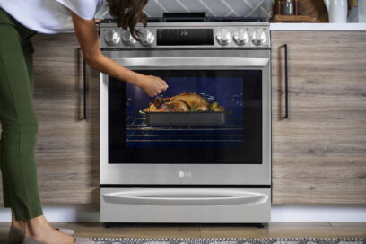 A woman is knocking on the glass window of the oven of InstaView® Range to see inside