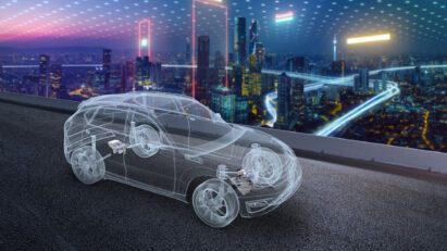 Illustration of a see-through electric vehicle cruising past the city skyline of Chongqing at night