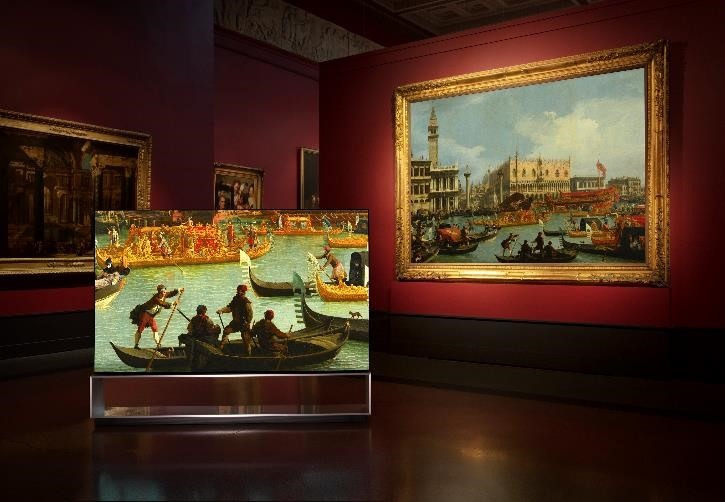 LG SIGNATURE OLED 8K TV positioned inside one of the Pushkin Museum's painting galleries as it displays one of its artworks