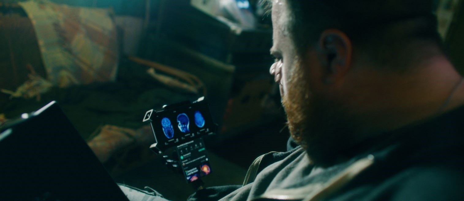An actor carefully looking at the screen of LG Wing in Swivel Mode
