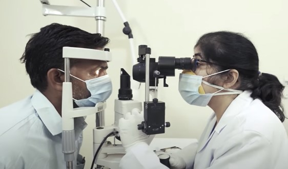 A doctor providing the proper medical care needed by giving a patient a thorough eye exam