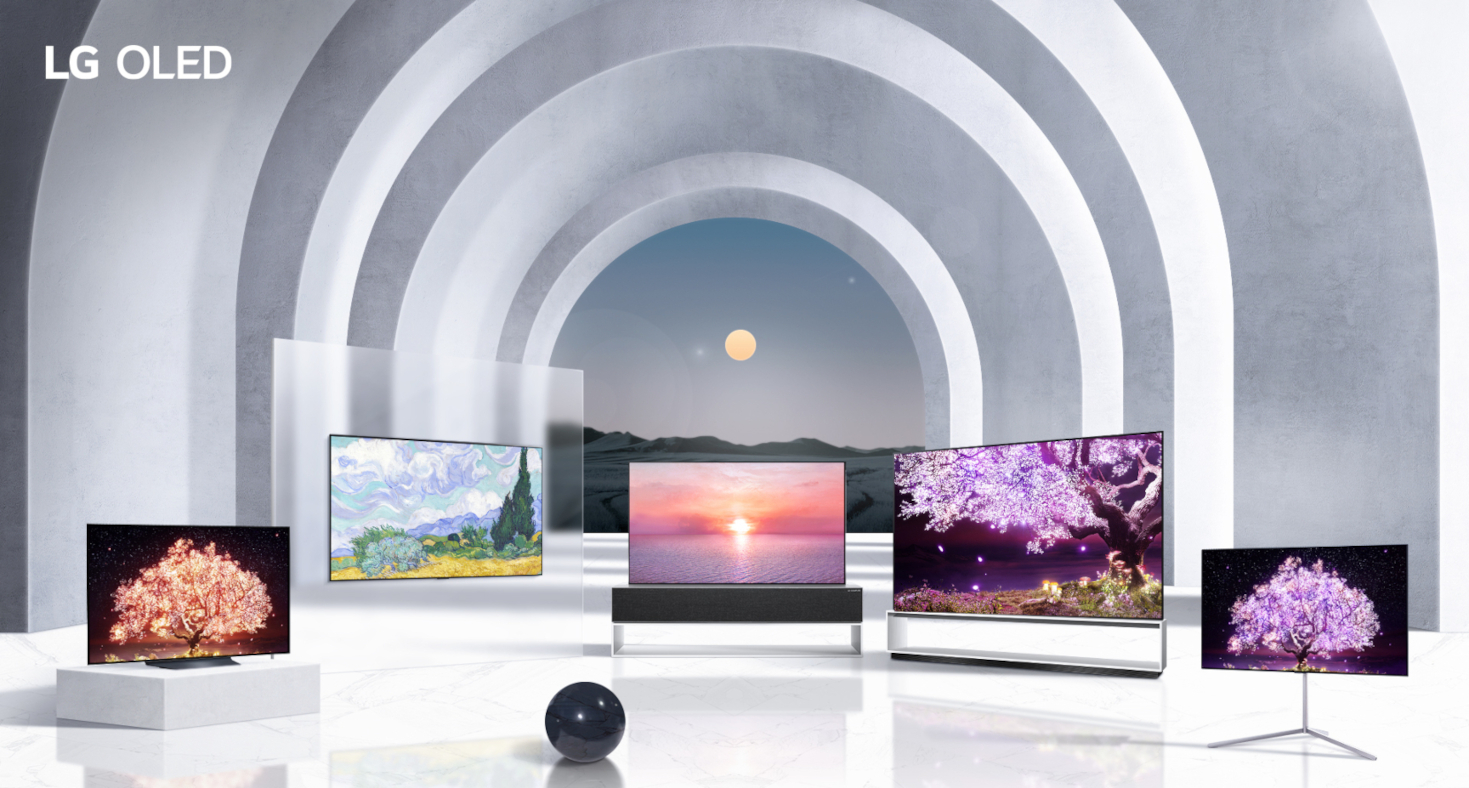 Five TVs from LG's 2021 OLED lineup standing side-by-side in a large and modern arched hallway