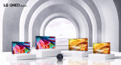 Four TVs from LG's QNED Mini LED lineup standing side by side in a large and modern arched hallway