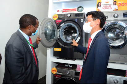 Kim Sa-nyoung, managing director of LG Electronics East Africa, explaining the features of LG's washing machine as COVID-19 safety protocols are strictly observed.
