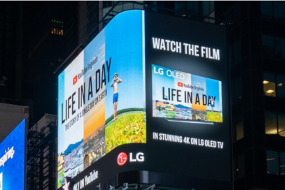 LG's enormous high-definition digital billboard in Time Square, New York, playing the YouTube Originals documentary 'Life in a Day.'