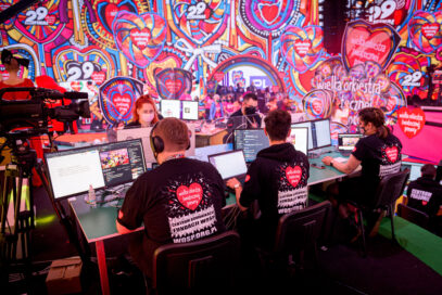 Volunteers at the 29th Annual Grand Finale fundraiser using the monitors provided by LG to support the online fundraising.