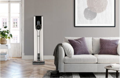 A photo of the CordZeroThinQ A9 Kompressor+ on its charging stand in a living room.