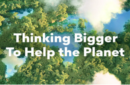 "An Aerial Photo of a forest with lakes representing the world's continents and the phrase ""Thinking Bigger To Help the Planet"" overlapping."