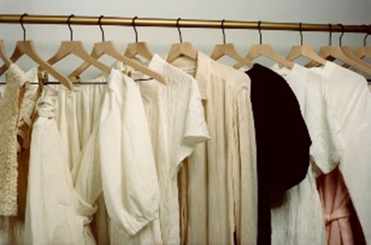 Elegant and sustainable women's clothing hanging on a rack.