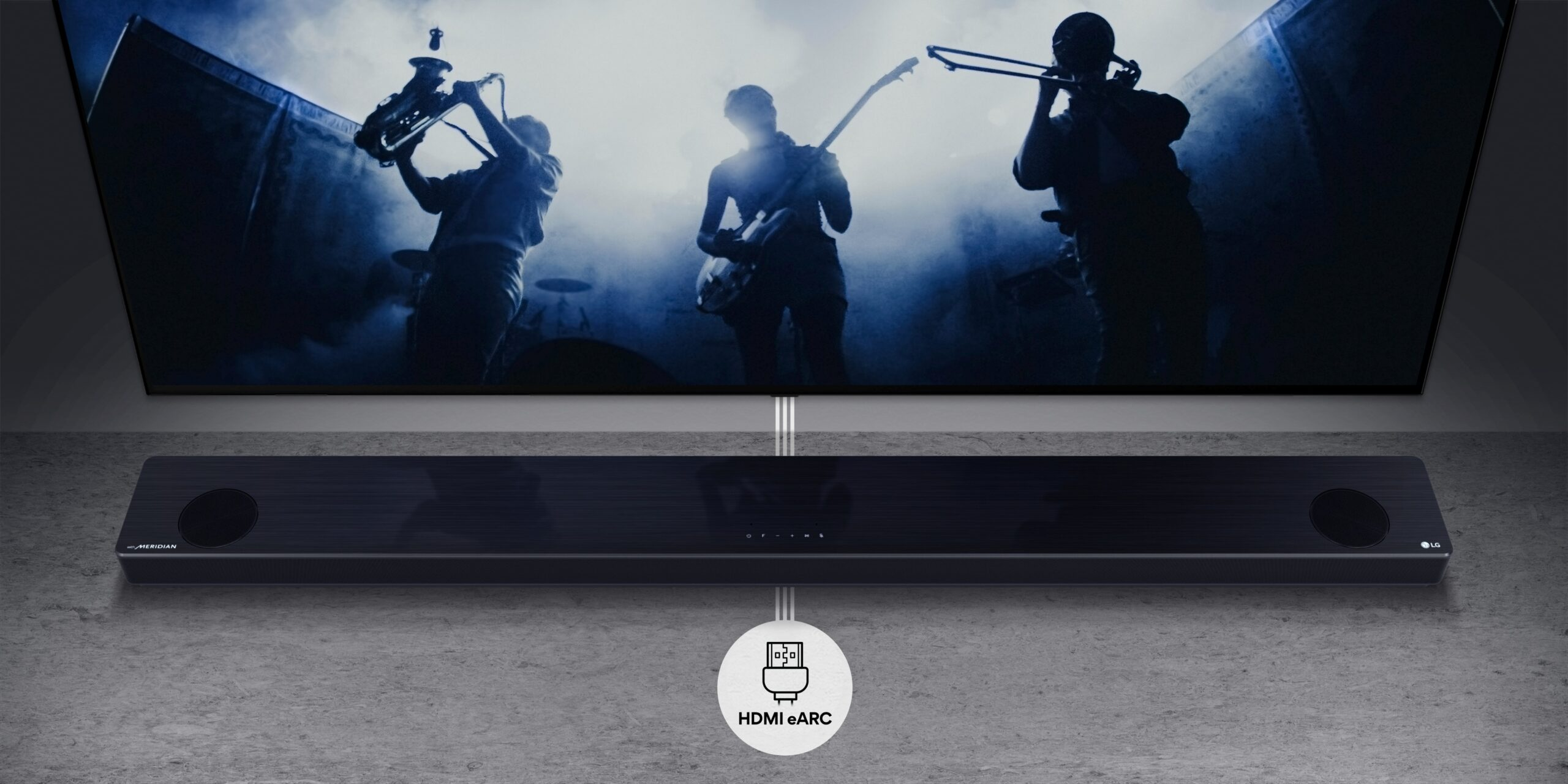 LG Soundbar with HDMI eARC support lying in front of an LG TV with a HDMI eARC symbol
