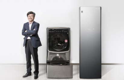 Dong-won Kim, Ph.D. Laboratory Leader of Living Appliance R&D Lab at LG, standing proudly next to the LG TWINWash and LG Styler appliances he invented.